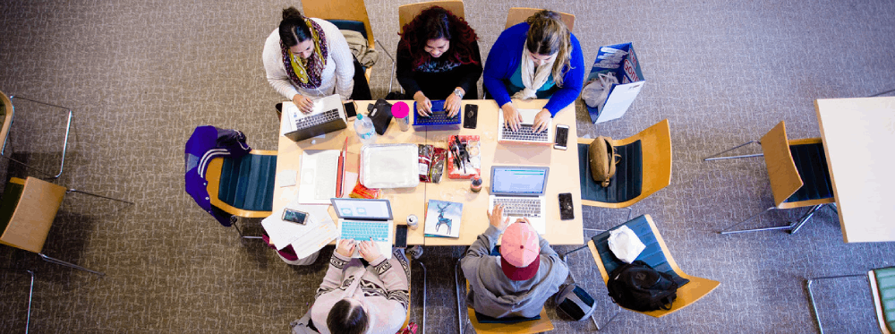 overhead view of students studying at table
